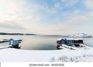 A beach south of Gothenburg, Sweden (Scandinavia) is covered in snow after heavy snowfall in December. You see little houses that are used in the summer to change clothes.