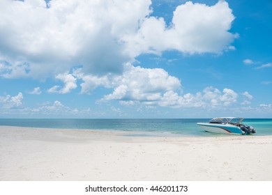 Beach, speed boat, and blue sky