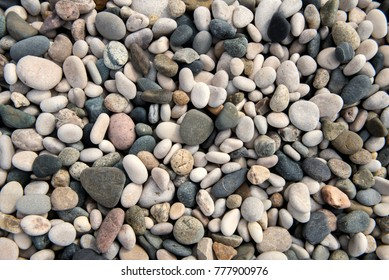 Beach stones background. Top view