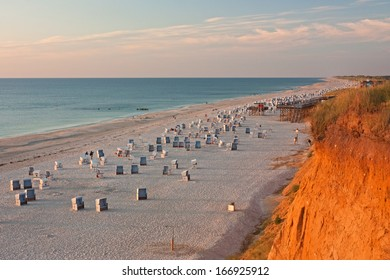 Beach with strandkorbs (beach basket chairs) at the Red Cliff(Rotes Kliff) near Kampen on Sylt at the North Sea, Schleswig-Holstein, Germany.