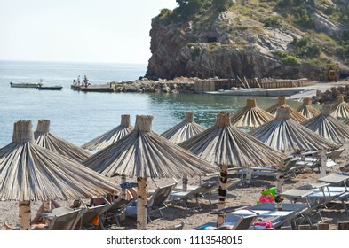 Beach with straw parasols