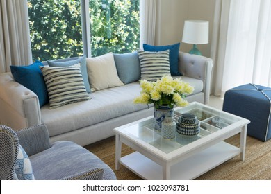 beach style color living room with vase flower and table lamp