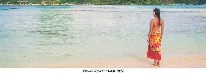 Beach summer polynesian skirt woman relaxing walking on sand and ocean background. Banner travel panorama concept. Hawaii, Tahiti clothing.