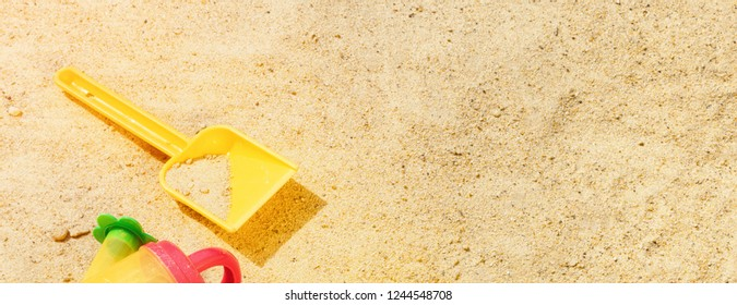 Beach Summer Sun Sand Kids Toys and bottle water slippers and Sunscreen concept of childrens leisure tourism entertainment games Skin Protection SPF UVA UVB radiation safety from Melanoma Cancer.