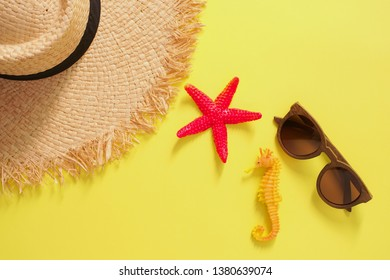 Beach summer travel holiday flat lay sun glasses starfish seahorse and woman hat background with accessories, Top view tourist traveler or vacation concept.
