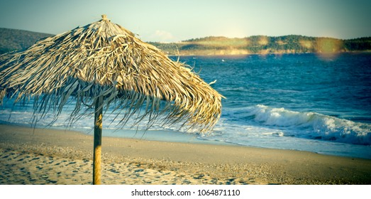 Beach with sun umbrellas (beach umbrella) - vocation concept