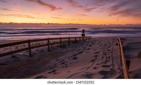 Beach Sunrise image taken in Assateague State Park in Maryland after a nor'easter storm. Beautiful peaceful sunrise concept.
