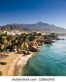 The beach at sunrise in a little town in the south of Andalucia called Nerja. Sierra Nevada mountains in the distance