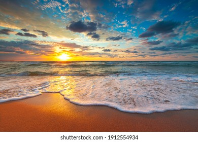 Beach sunrise over the tropical sea