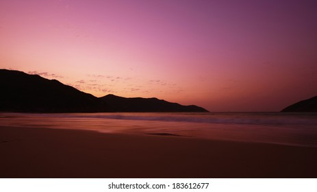 Beach sunrise with red sky