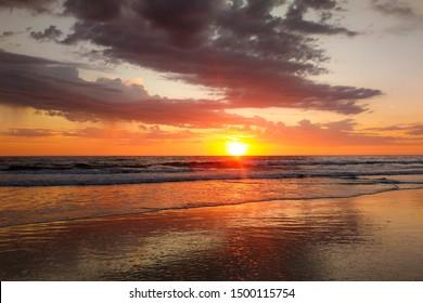Beach sunset after a storm.
