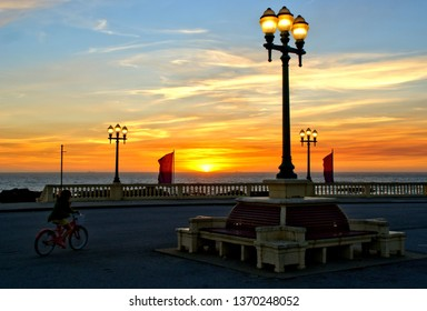 Beach sunset with lamps in Oporto,  north of Portugal