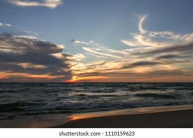 Beach sunset on Lake Michigan.  Saugatuck, MI, USA.