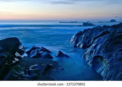 Beach sunset in Oporto, north of Portugal