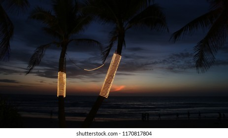 Beach at sunset with palm trees