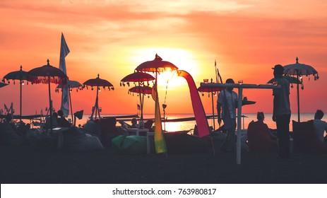 beach sunsets over Lovina, bali.
