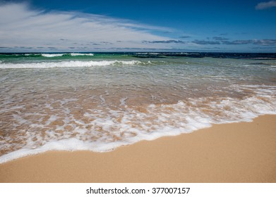 A beach with sunshine and wave in day time