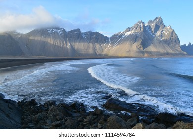 A beach surrounded by mountains, in Iceland