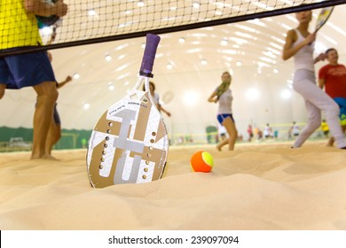 Beach tennis team workout on covered court