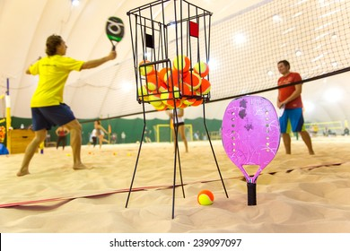 Beach tennis training on sand covered court