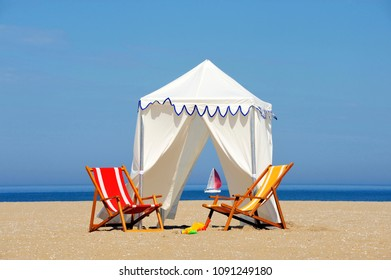 Beach tent with two chairs at the seaside