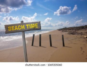 Beach time sign on coastal background