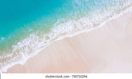 Beach top view or aerial view with shade emerald blue water and wave foam,soft focus