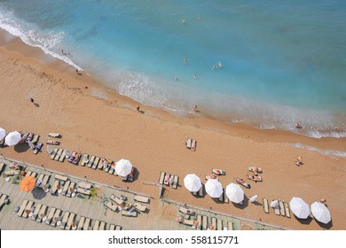Beach top view in Antalya. Beach with parasols