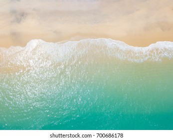 Beach top view with wave foam