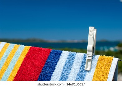 Beach towel hanging on a rope, seaside background