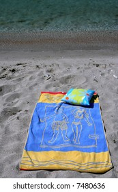 Beach towel on seacoast in a sunny day