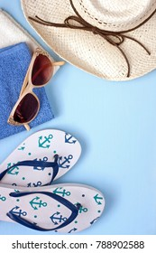 Beach towel, sunglasses  and  hat  on  wooden background