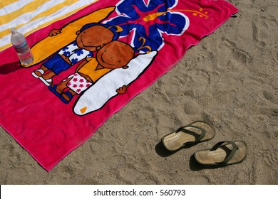 Beach towels and flip-flops at the beach in Ventura, California.