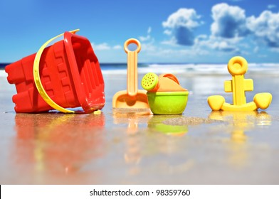 Beach toys on the beach with sea in the background