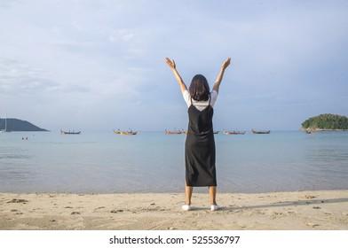 Beach travel - woman walking on sand beach