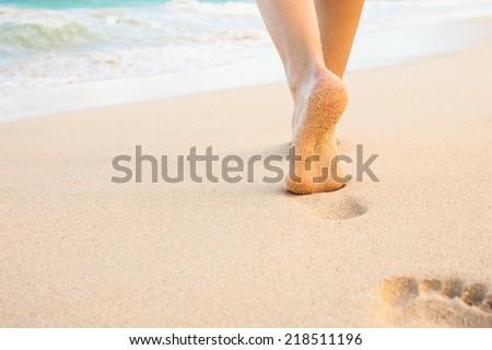 5ebf87955 ... Stock Photo (Edit Now) 218511196 - Shutterstock. Beach travel - woman  walking on sandy beach leaving footprints in the sand. Closeup detail