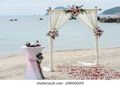 Beach tropical arch wedding white with flowers in Thailand