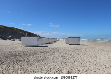 Løkken beach with two rows of white beach houses, dunes and the sea