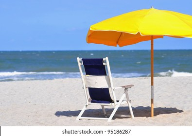Beach Umbrella and Beach Chair, room for your text