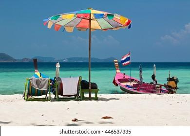 Beach umbrella in Komodo beach in Coral island, Thailand
