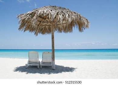 Beach umbrella made of palm branches on the beach in Varadero, Cuba
