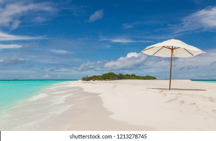 Beach umbrella on the beach Atoll island Maldives.