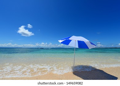 Beach umbrella on a sunny beach