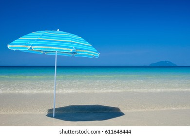 Beach umbrella on a sunny day on  background clean sea and islands.