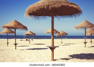 Beach umbrella on sunny day with sea background