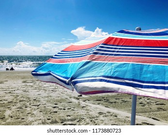 Beach umbrella at the seashore.