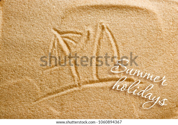 A beach umbrella and a surfboard are painted on the sand and an inscription of summer holidays. Beach background. View from above. The concept of summer, summer kanikkuly, vacation, holydays.