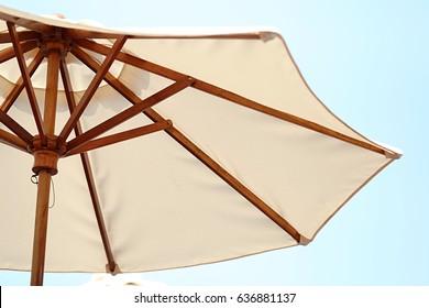 Beach umbrella white fabric and blue sky nature tropical summer background