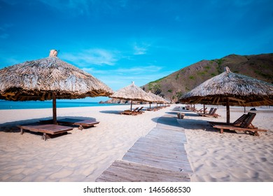 beach with umbrellas made of tree leaves at Ky Co, Quy Nhon city  - Shutterstock ID 1465686530