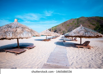 beach with umbrellas made of tree leaves at Ky Co, Quy Nhon city  - Shutterstock ID 1465686536
